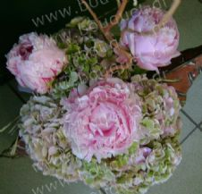 Peonies and hydrangeas in a metal pot